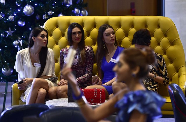 Miss World 2014 finalists wait during a publicity launch in central London November 25, 2014. (Photo by Toby Melville/Reuters)