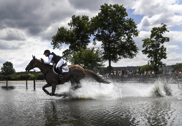 Marilyn Little, riding RF Demeter, pats her horse as they take off after complete a pair of water jumps during the cross country portion of the Land Rover Great Meadow Invitational on Sunday, July 10, 2016. (Photo by Toni L. Sandys/The Washington Post)
