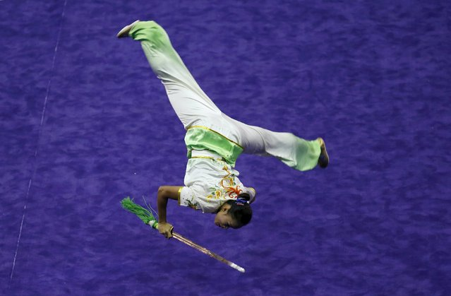 Myanmar's Sandy Oo competes in the women's jianshu final during the 13th World Wushu Championship 2015 at Istora Senayan stadium in Jakarta, November 17, 2015. (Photo by Reuters/Beawiharta)