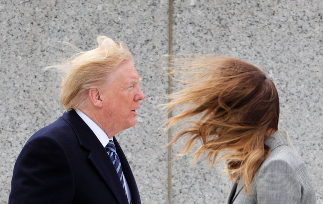 U.S. President Donald Trump and first lady Melania Trump brace themselves against strong winds during a Victory in Europe Day 75th anniversary ceremony at the World War II Memorial in Washington, U.S., May 8, 2020. (Photo by Tom Brenner/Reuters)