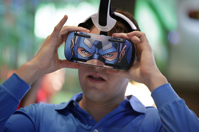 A brand ambassador tests Samsung's Gear VR headset at the Samsung Galaxy booth at the International CES Tuesday, January 6, 2015, in Las Vegas. (Photo by Jae C. Hong/AP Photo)