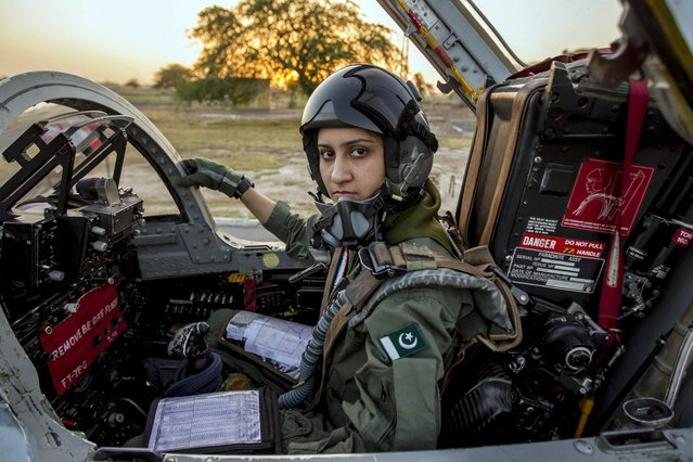 Ayesha Farooq, 26, Pakistan's only female war-ready fighter pilot, poses for photograph as she sits in a cockpit of a Chinese-made F-7PG fighter jet at Mushaf base in Sargodha, north Pakistan June 6, 2013. (Photo by Zohra Bensemra/Reuters)