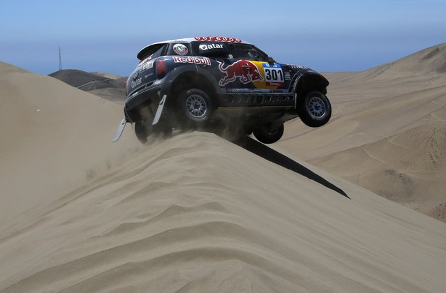Mini driver Nasser Al-Attiyah of Qatar drives during the sixth stage of the Dakar Rally 2015, from Antofagasta to Iquique, January 9, 2015. (Photo by Jean-Paul Pelissier/Reuters)