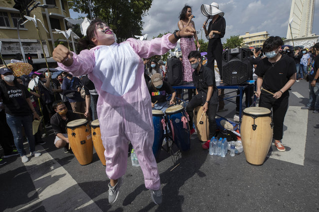 Pro-democracy students dance during a rally in Bangkok, Thailand, Sunday, August 16, 2020. Protesters have stepped up pressure on the government if it failed to meet their demands, which include holding of new elections, amending the constitution, and an end to intimidation of critics. (Photo by Sakchai Lalit/AP Photo)