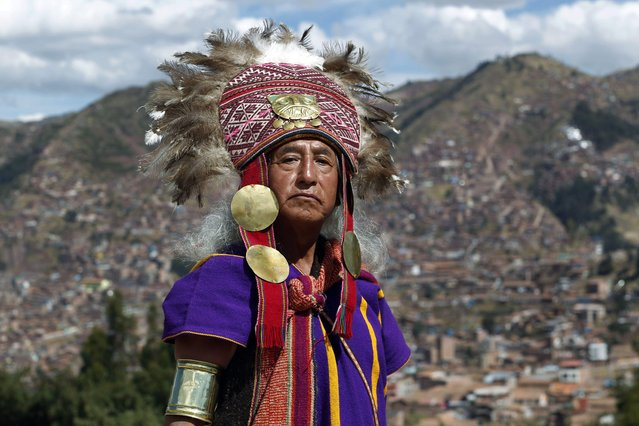 "An actor dressed as an Inca priest, poses for a portrait before celebrating the Inca ceremony ""Inti Raymi,"" at the Saqsaywaman ruins in Cuzco, Peru, Sunday, June 24, 2018. (Photo by Martin Mejia/AP Photo)"