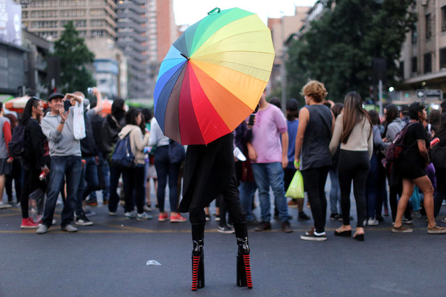 A protester wearing high heels during a demonstration to support International Day for the Elimination of Violence Against Women in Santiago, Chile, November 25, 2016. (Photo by Pablo Sanhueza/Reuters)