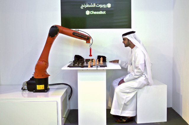 Wafi Dawood, the Chief of Strategy & Excellence of Knowledge & Human Development Authority of the Dubai Government competes with a ChessBot during the second day of the Government Summit in Dubai, United Arab Emirates, Tuesday, February 10, 2015. (Photo by Kamran Jebreili/AP Photo)