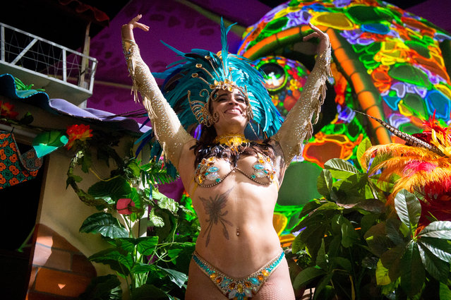 Dancers perform during the Sambodromo do Brasil jungle party in the Cave stage, Elrow Town at Queen Elizabeth Olympic Park on August 18, 2018 in London, England. (Photo by Ollie Millington/Redferns)
