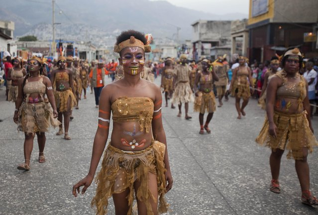 Dancers file past in a Carnival parade to the national palace in Port-au-Prince, Haiti, Monday, February 16, 2015. (Photo by Dieu Nalio Chery/AP Photo)