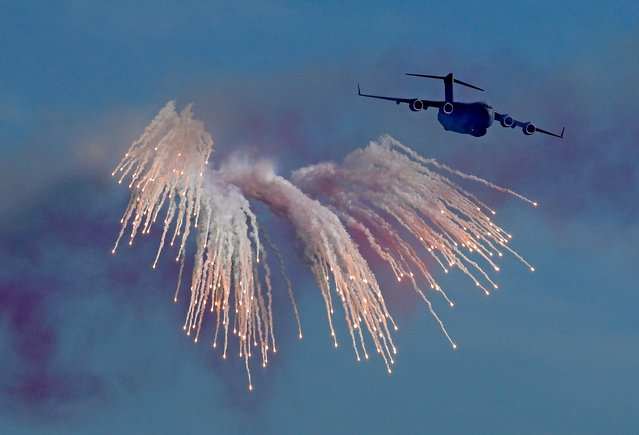 A Boeing C-17 military transport aircraft of the Qatar Air Force performs during a military parade to mark Qatar's national day celebration, in the capital Doha on December 18, 2020. (Photo by AFP Photo/Stringer)