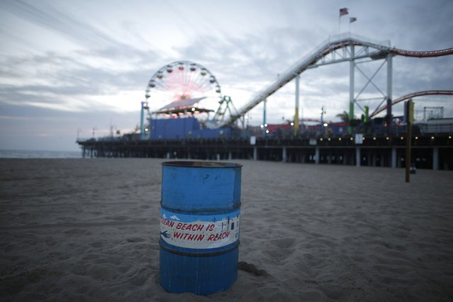 An old oil barrel is used as a rubbish bin on the beach in Santa Monica, California February 5, 2015. (Photo by Lucy Nicholson/Reuters)