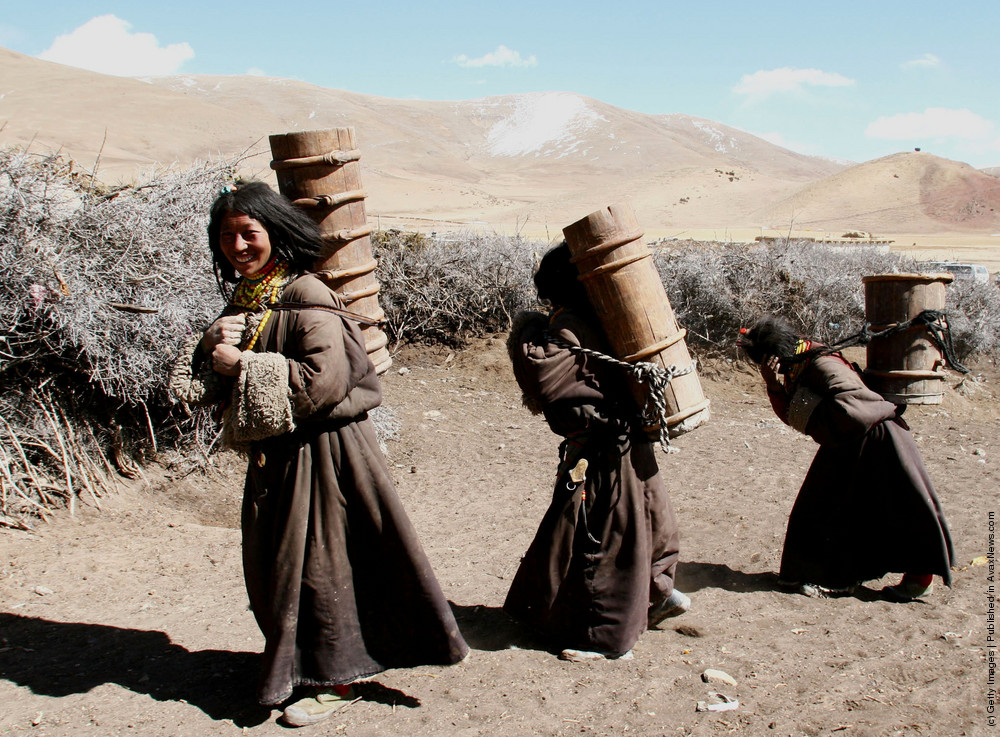Kangba Women Fetch Water With Traditional Barrels