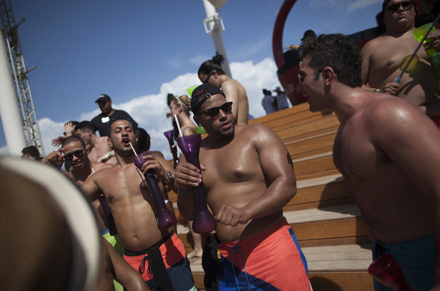 Spring breakers gather at a pool party at a hotel in Cancun March 14, 2015. (Photo by Victor Ruiz Garcia/Reuters)
