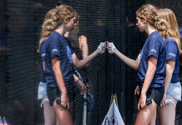 Athena Tedder and Norah Benedict, students at Michigan's Clarkston Junior High School visit the Vietnam Memorial during their 8th grade trip to Washington, U.S., June 18, 2021. Picture taken June 18, 2021. (Photo by Evelyn Hockstein/Reuters)