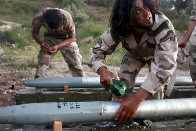 Tajammu Al-Ezza brigade fighters prepare Grad shells before firing them towards forces of Syria's President Bashar Al-Assad stationed at Salhab village, in the Hama countryside May 7, 2015. (Photo by Mohamad Bayoush/Reuters)