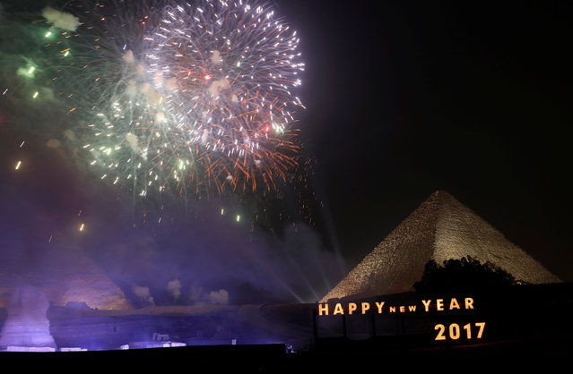 Fireworks explode above the pyramids during New Year's day celebrations on the outskirts of Cairo, Egypt, January 1, 2017. (Photo by Mohamed Abd El Ghany/Reuters)