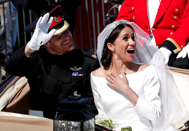 Britain's Prince Harry and his wife Meghan ride a horse-drawn carriage after their wedding ceremony at St George's Chapel in Windsor Castle in Windsor, Britain, May 19, 2018. (Photo by Benoit Tessier/Reuters)