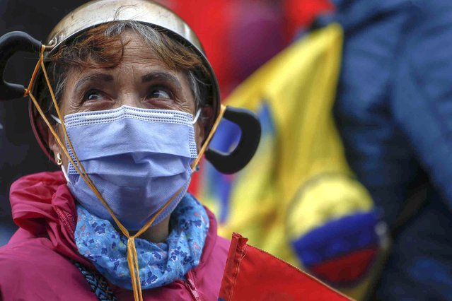 A woman takes part in an anti-government protest in Bogota, Colombia, Tuesday, July 20, 2021, as the county marks its Independence Day. (Photo by Ivan Valencia/AP Photo)