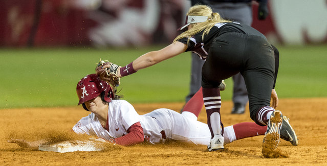 Texas A&M infielder Kristen Cuyos (17) applies the tag but Alabama outfielder Rachel Bobo (4) is safe stealing second during an NCAA college softball game, Friday, March 27, 2015, at Rhoads Stadium in Tuscaloosa, Ala. (Photo by Vasha Hunt/AP Photo/AL.com)