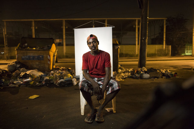 "In this March 14, 2015 photo, Andre Oliveira, 32, poses for a portrait in an open-air crack cocaine market, known as a ""cracolandia"" or crackland, where users can buy crack, and smoke it in plain sight, day or night, in Rio de Janeiro, Brazil. Andre makes a living by collecting discarded, recyclable items on the streets. (Photo by Felipe Dana/AP Photo)"