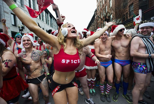 "Runners gather at the start line for the annual ""Santa Speedo Run"", a charity race through the streets of the Back Bay neighborhood of Boston. (Photo by Gretchen Ertl/Reuters)"