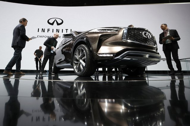 Journalists look over an Infiniti Q60 concept car being displayed during the North American International Auto Show in Detroit, Michigan, U.S., January 10, 2017. (Photo by Mark Blinch/Reuters)