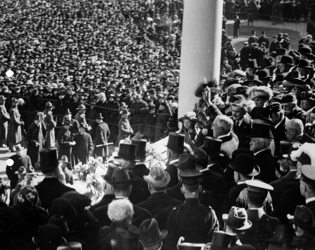Warren Harding waves to the crowd after being sworn in on the east portico of the Capitol in Washington, D.C., U.S. in 1921. Harding's inauguration was the first to feature an automobile, used to transport the president-elect and outgoing President Wilson to and from the Capitol. (Photo by Reuters/Library of Congress)