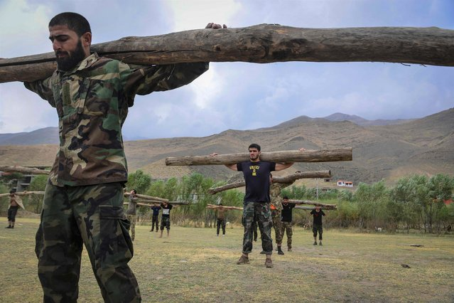 Afghan resistance movement and anti-Taliban uprising forces take part in a military training in Panjshir province on August 30, 2021. (Photo by Ahmad Sahel Arman/AFP Photo)