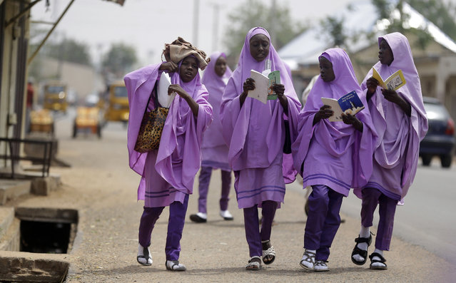School girls walk on the streets in Yola, Nigeria, Monday February 25, 2019. (Photo by Sunday Alamba/AP Photo)
