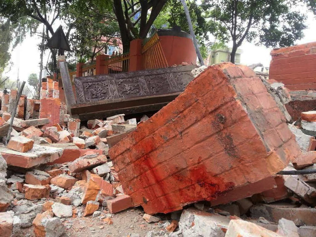 In this photo released by China's Xinhua News Agency, a collapsed building is seen in Nepal's capital Kathmandu Saturday, April 25, 2015. (Photo by Zhou Shengping/Xinhua via AP Photo)