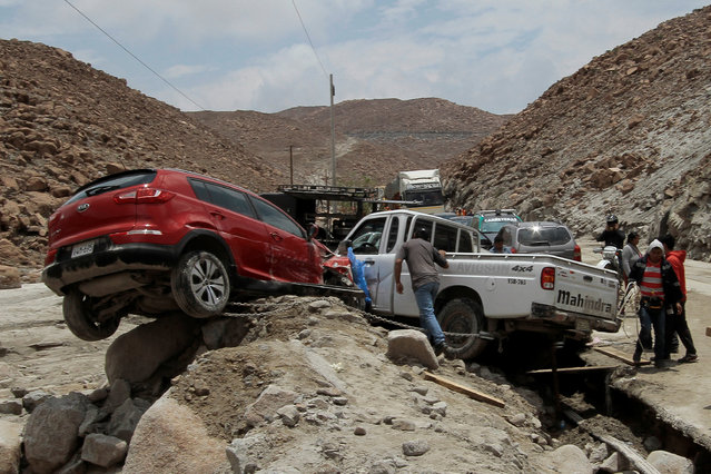 Cars affected by a massive landslide and flood are seen in Arequipa, Peru January 27, 2017. (Photo by Freddy Salcedo/Reuters)