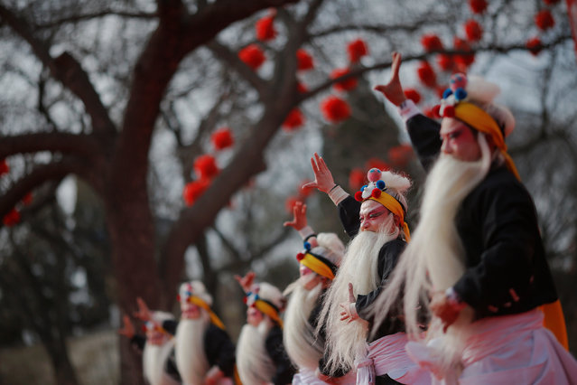 Performers in traditional costumes dance on the stage at the Longtan park as the Chinese Lunar New Year, which welcomes the Year of the Rooster, is celebrated in Beijing, China January 29, 2017. (Photo by Damir Sagolj/Reuters)