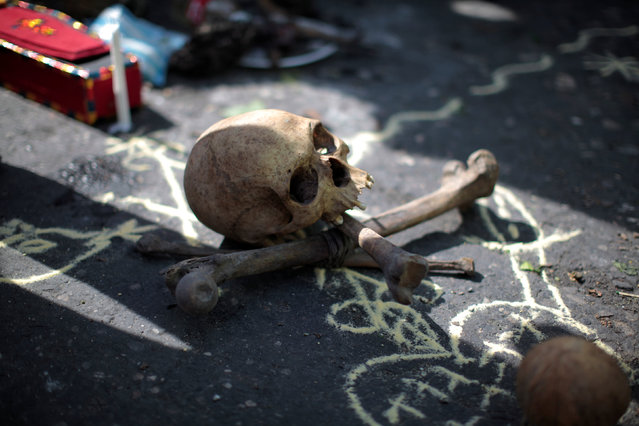 A skull and bones for a voodoo ritual are pictured before a protest against the results of the presidential election in Port-au-Prince, Haiti, December 16, 2016. (Photo by Andres Martinez Casares/Reuters)