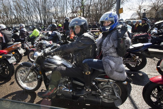Members of the Night Wolves biker  group gather to see off Russian bikers leaving for Germany to mark the 70th anniversary of Soviet victory over Nazi Germany, in Moscow, Saturday, April 25, 2015. Riders from the Night Wolves, a Russian nationalist motorcycle group, have begun their run commemorating the Red Army's offensive against Nazi Germany, despite Poland's announcement that it would refuse to let them in the country. (Photo by Alexander Zemlianichenko/AP Photo)