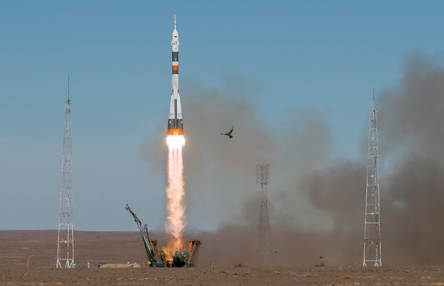 The Soyuz MS-10 spacecraft carrying the crew of astronaut Nick Hague of the U.S. and cosmonaut Alexey Ovchinin of Russia blasts off to the International Space Station (ISS) from the launchpad at the Baikonur Cosmodrome, Kazakhstan October 11, 2018. (Photo by Shamil Zhumatov/Reuters)