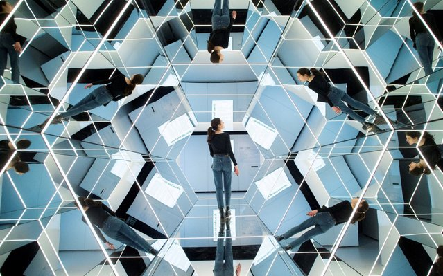 """A woman visits the exhibition """"Mirrors: In and Out of Reality"""" in Barcelona, Spain, 12 April 2019. Maths, physics and photonics melt in this exhibition presented by Cosmocaixa in which visitors can enter a big kaleidoscope to walk through and experience with the effects and particularities of mirrors. The exhibition will be open to public from 12 April to 06 June 2019. (Photo by Quique Garcia/EPA/EFE)"""