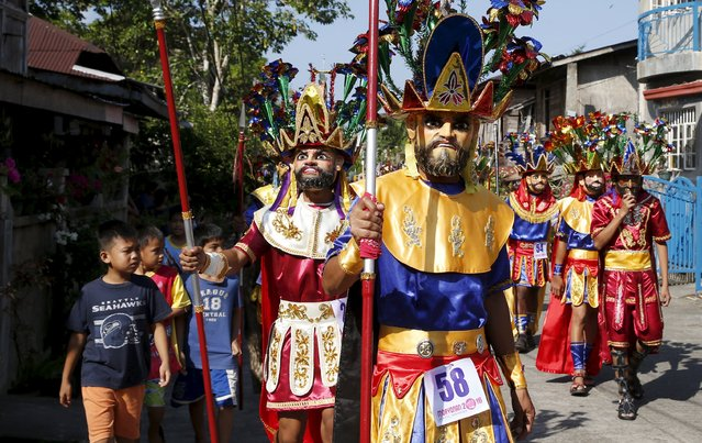 """Penitents locally called """"Morions"""" take part in a parade during the start of Holy Week celebration in Mogpog, Marinduque in central Philippines March 21, 2016. (Photo by Erik De Castro/Reuters)"""