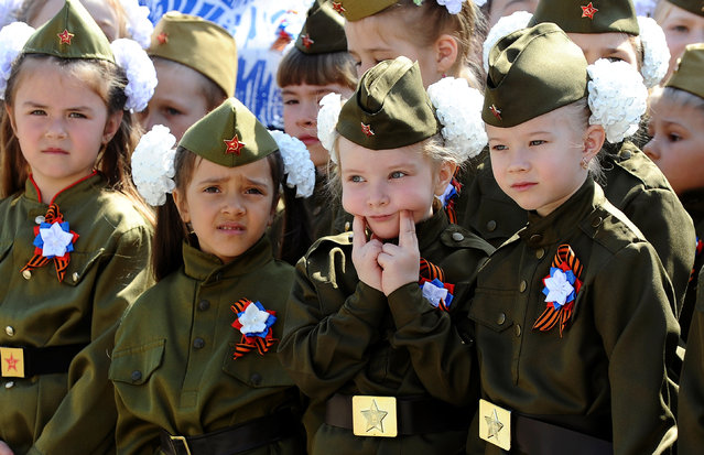 Children wearing military uniform take part in a parade, held by Russian servicemen, pupils of infant and primary schools, which is a public event to honour World War Two veterans and to mark the upcoming Victory Day, in Rostov-on-Don, Russia on April 25, 2019. (Photo by Sergey Pivovarov/Reuters)