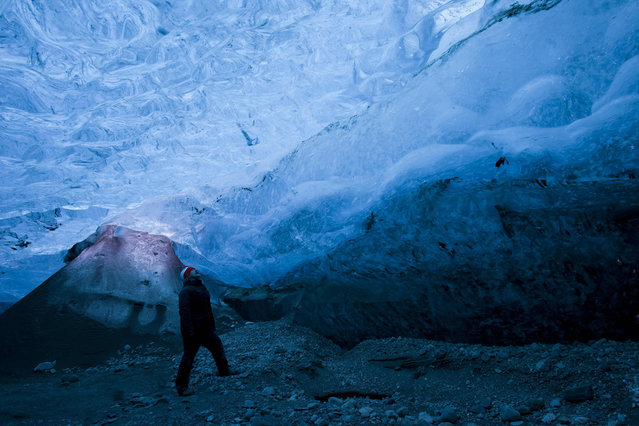 A view of Rob Lott standing in the crystal ice cave in the Vatnajokull Glacier, Iceland. (Photo by Rob Lott/Barcroft Media)