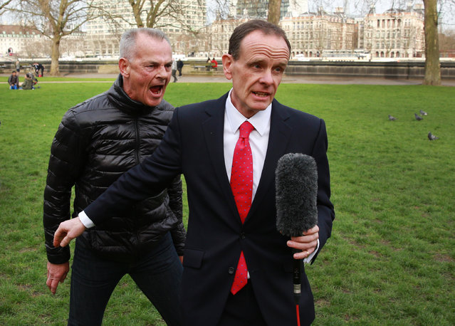 Protestor Bill Maloney (L) shouts during a live TV broadcast by BBC News Channel chief political correspondent Norman Smith after earlier forcing Deputy Prime Minister Nick Clegg to abandon a photocall near Parliament on March 19, 2014 in London, England. The Chancellor of the Exchequer, George Osborne has delivered his Budget statement to Members of Parliament in the House of Commons. (Photo by Peter Macdiarmid/Getty Images)