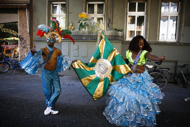 Samba dancers rehearse their performance prior to at the annual Carnival of Cultures parade in Berlin, Germany, Sunday, May 24, 2015. (Photo by Markus Schreiber/AP Photo)