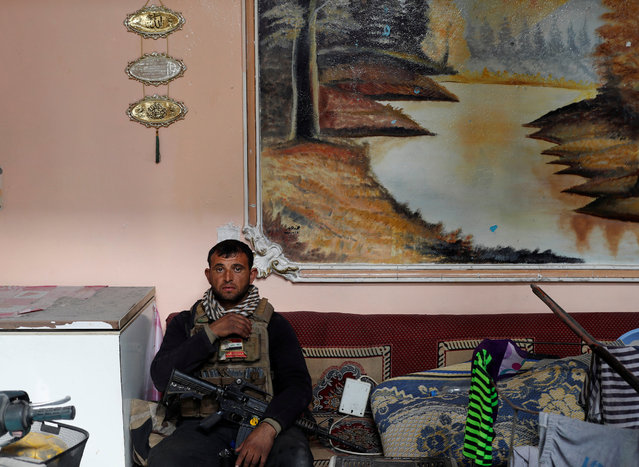 An Iraqi special forces member takes a rest inside a house during a battle with Islamic State militants in Mosul, Iraq March 1, 2017. (Photo by Goran Tomasevic/Reuters)