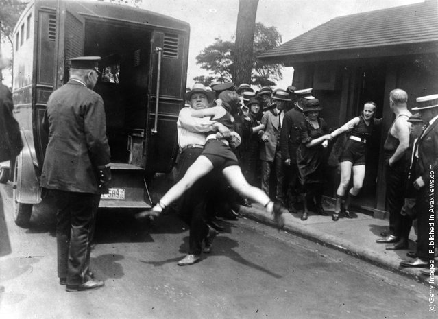 Women in Chicago being arrested for wearing one piece bathing suits, without the required leg coverings, 1922