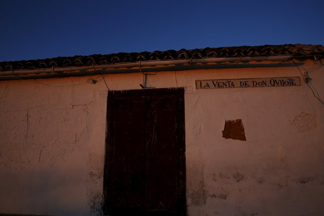 The morning sun illuminates an old inn named after Don Quixote in the outskirts of El Toboso, Spain, April 7, 2016. (Photo by Susana Vera/Reuters)