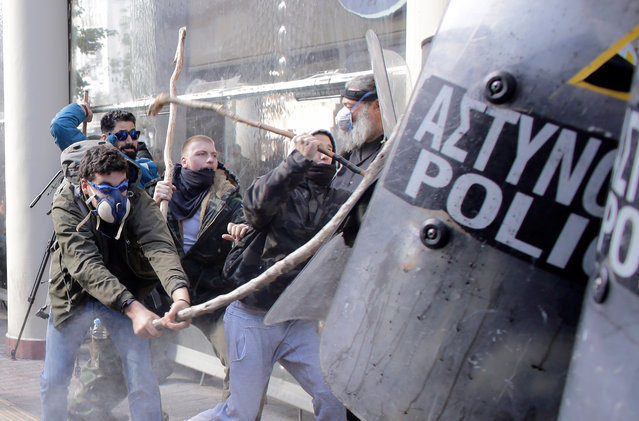 Farmers with shepherds crooks clash with riot policemen during a protest outside the Greek Agriculture Ministry on March 8, 2017 in Athens, Greece. (Photo by Milos Bicanski/Getty Images)