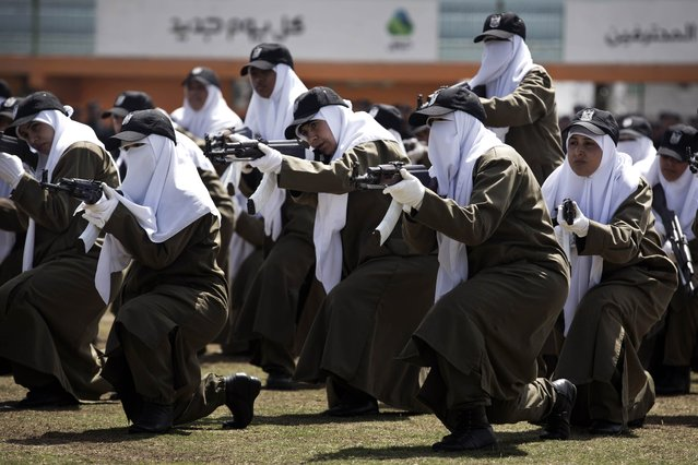 Female members of Palestinian security forces loyal to Hamas show their skills during a military graduation ceremony in Gaza City on April 2, 2014. The Hamas-ruled Gaza Strip has been under blockade since 2006, after militants captured an Israeli soldier in a cross-border raid. (Photo by Mohammed Abed/AFP Photo)