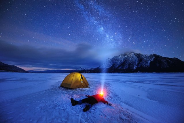 These amazing pictures capture a photographer entranced by the night sky – wearing a head lamp and gazing at the stars. (Photo by Caters News)