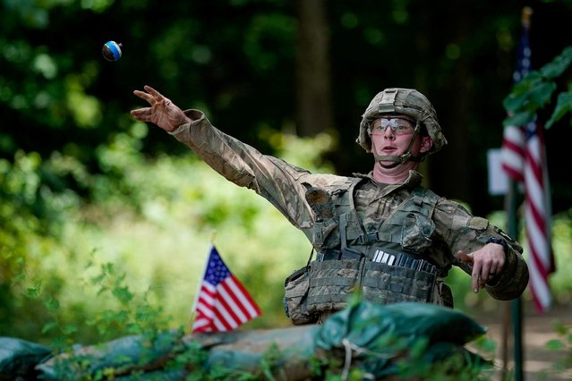 A soldier with the 3rd Brigade Combat Team 101st Airborne Division (Air Assault) throws a practice grenade during Expert Infantryman Badge training at Fort Campbell, Kentucky. U.S., July 25, 2019. (Photo by Bryan Woolston/Reuters)