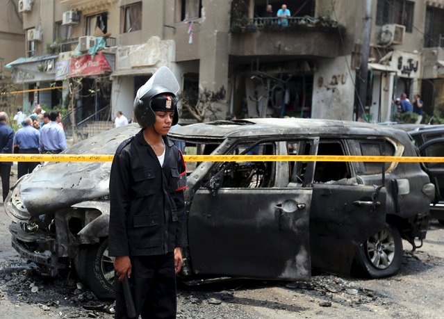 Policemen investigate the site of a car bomb attack on the convoy of Egyptian public prosecutor Hisham Barakat near his house at Heliopolis district in Cairo, Egypt, June 29, 2015. Barakat was injured when a car bomb struck his convoy as it was leaving his home in Cairo on Monday, in a high-profile attack against the judiciary, security and judicial sources said. (Photo by Mohamed Abd El Ghany/Reuters)