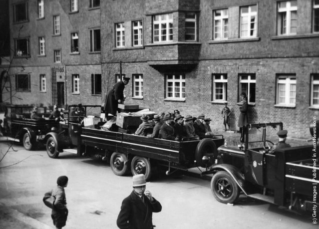 The Berlin police raid a community of artists and journalists in South West Berlin. Trucks containing confiscated material and prisoners are being driven away, 1933